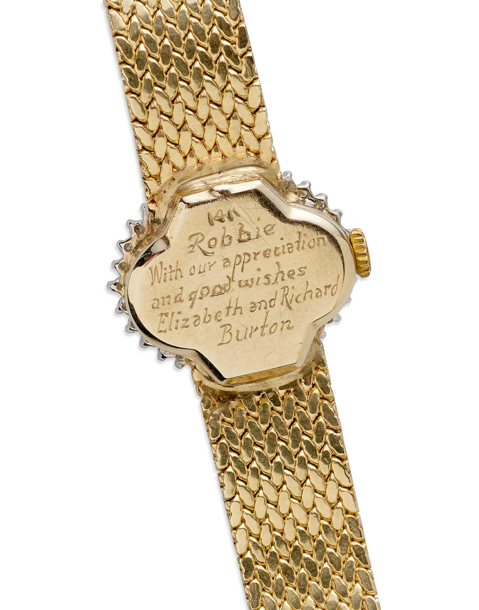 A Richard Burton and Elizabeth Taylor gifted engraved wrist watch with letters and photographs