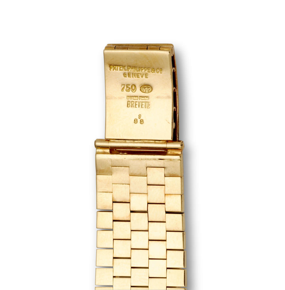 Patek Philippe. A fine and rare 18K gold enamel dial automatic wristwatch and braceletRetailed by Gübelin Ref: 2526, 1954