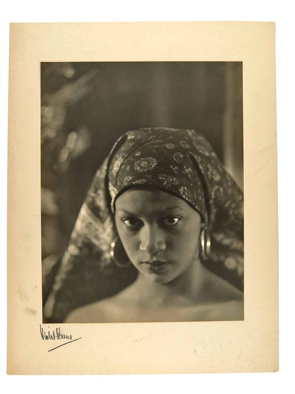 Keene, Minna. 1861-1943. Malay Woman S.Africa, in traditional Dress. Carbon print. 250 x 190mm. Mounted on card. [Cape Town c.1905, but this a later copy mid 1930s].