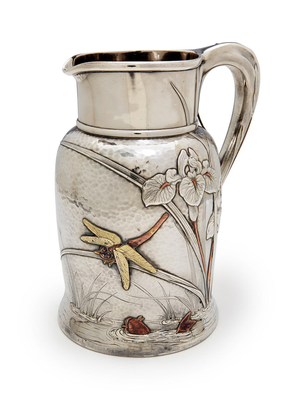 Tiffany & Co. (Founded 1837) Water Pitchercirca 1880silver and mixed-metals, in the Japanesque taste, spot-hammered with applied decoration, stamped 'Tiffany & Co. Makers 5051/ Sterling Silver/8280/925-1000' and initial M for Edward C. Moore, 1873-91height 9in (23cm)gross weight 36oz