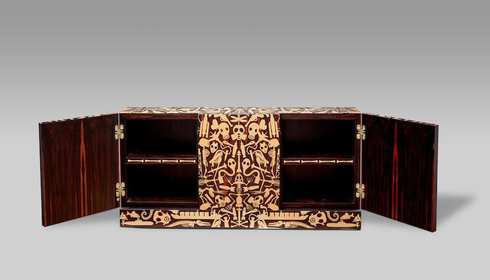 Studio Job (Founded 1998) Unique Industry/Perished Dressoir2006macassar ebony, exterior inlaid with birds's eye maple, interior with partial inlay to shelf edge and 'JOB' tag, inlaid dedication with motif of two primate skeletons to the reverseheight 37 1/2in (95cm); width 78 3/4in (200cm); depth 13 3/4in (35cm)