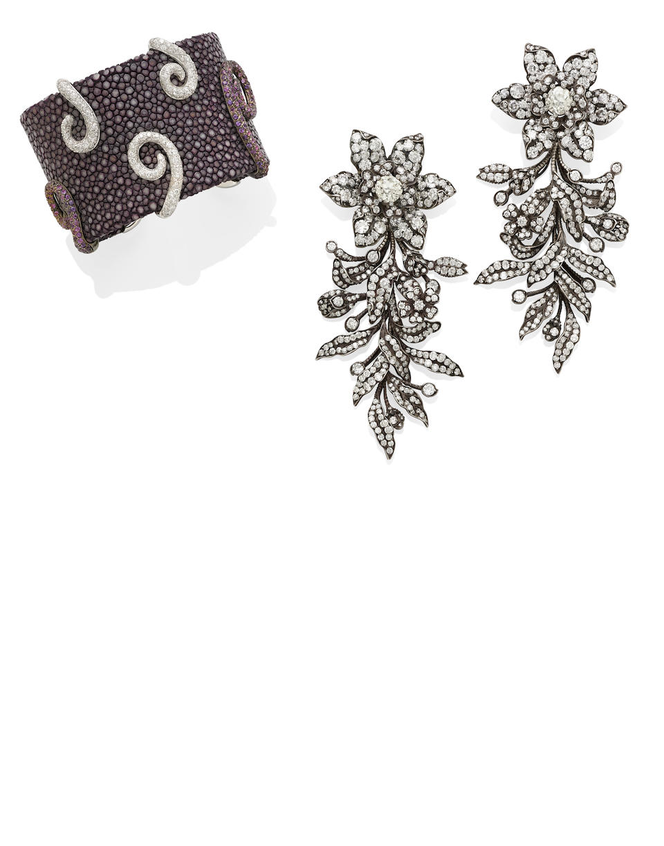 A pair of diamond brooches