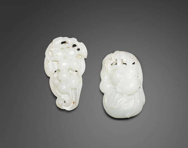 Two carved jade pendants (2)