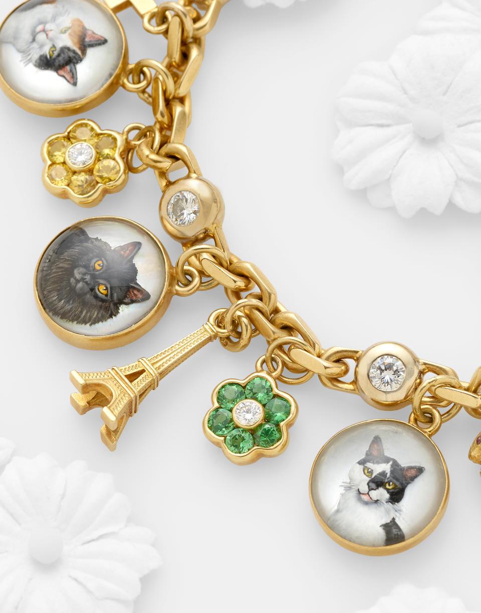 A diamond and gem-set charm bracelet, Asprey & Garrard