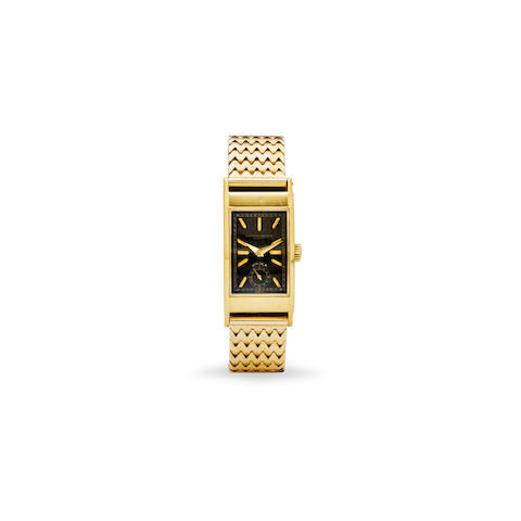 Patek Philippe. A fine 18K gold rectangular wristwatch with black dial and a 14K gold braceletRetailed by Brock & Co., Los Angeles Ref: 425, 1937
