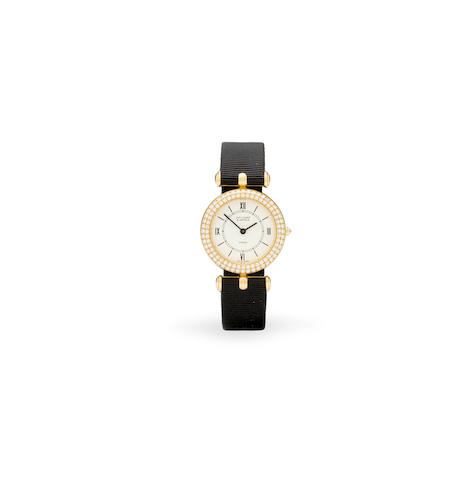 Van Cleef & Arpels. An 18K gold and diamond lady's wristwatch Classique, 1990's