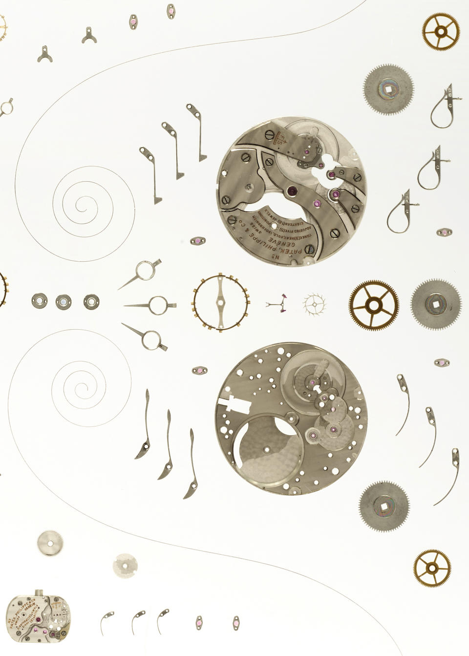 A fine group of four disassembled Patek Philippe movements displayed in an acrylic panel
