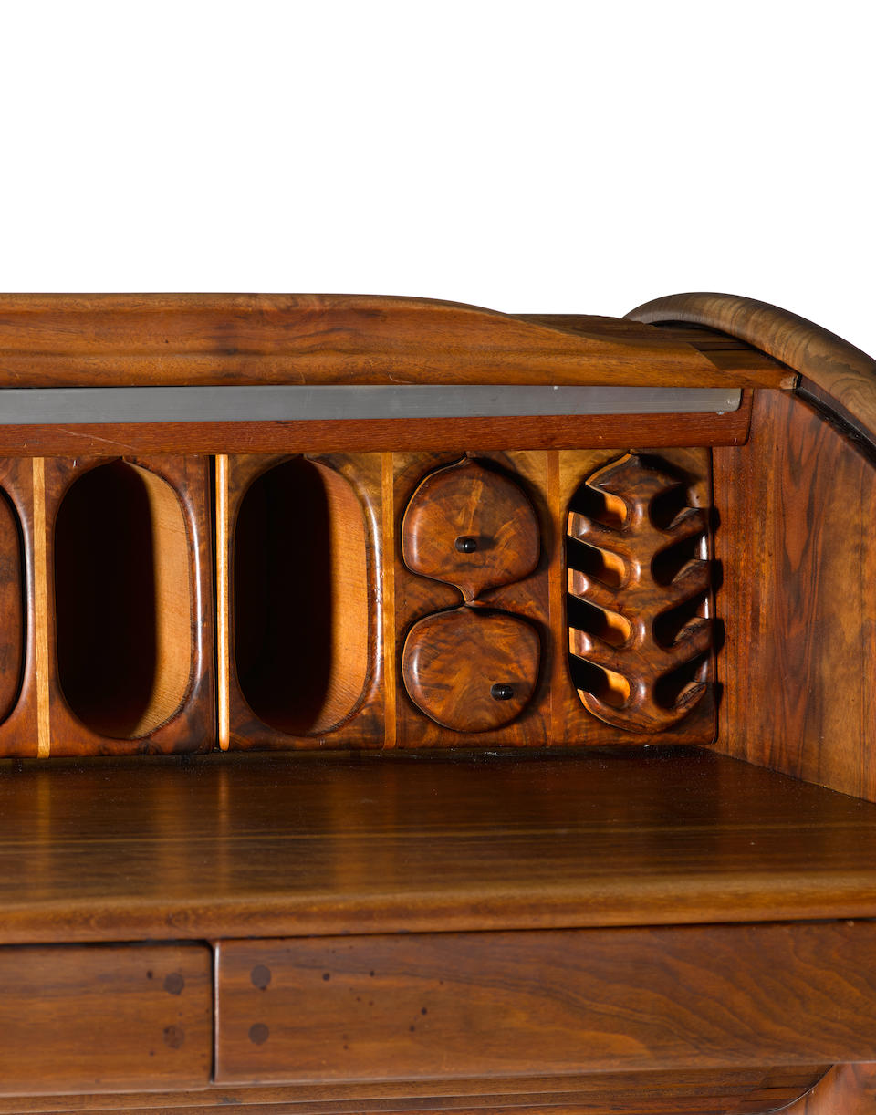 Arthur Espenet Carpenter (1920-2006) Roll Top Desk1976with tambour top and fitted interior, black walnut, incised 'Espenet 7607'height 38 1/2in (98cm); width 54 1/4in (138cm); depth 29in (74cm)