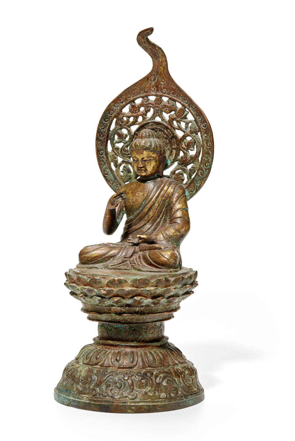 A gilt metal alloy figure of the seated Buddha