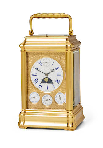 A fine gilt grande sonnerie quarter repeating giant carriage clock with seconds indication, moon phase, day, date and alarmRetailed by E & E Emanuel, Portsea & Paris Last quarter 19th century
