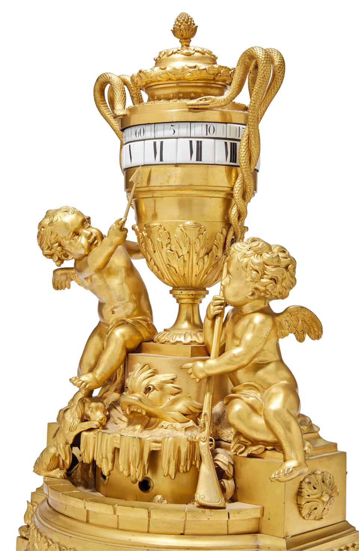 """A fine Louis XVI style ormolu urn form pendule à cercles tournantsThe movement stamped """"Douillon à St. Nicholas / M'tion Honor'le"""" Circa 1830"""
