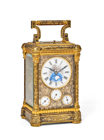 A fine engraved three‐color gold and patinated brass grande sonnerie quarter repeating carriage clock with calendar, moon phase and alarmFor the Spanish market Last quarter 19th century