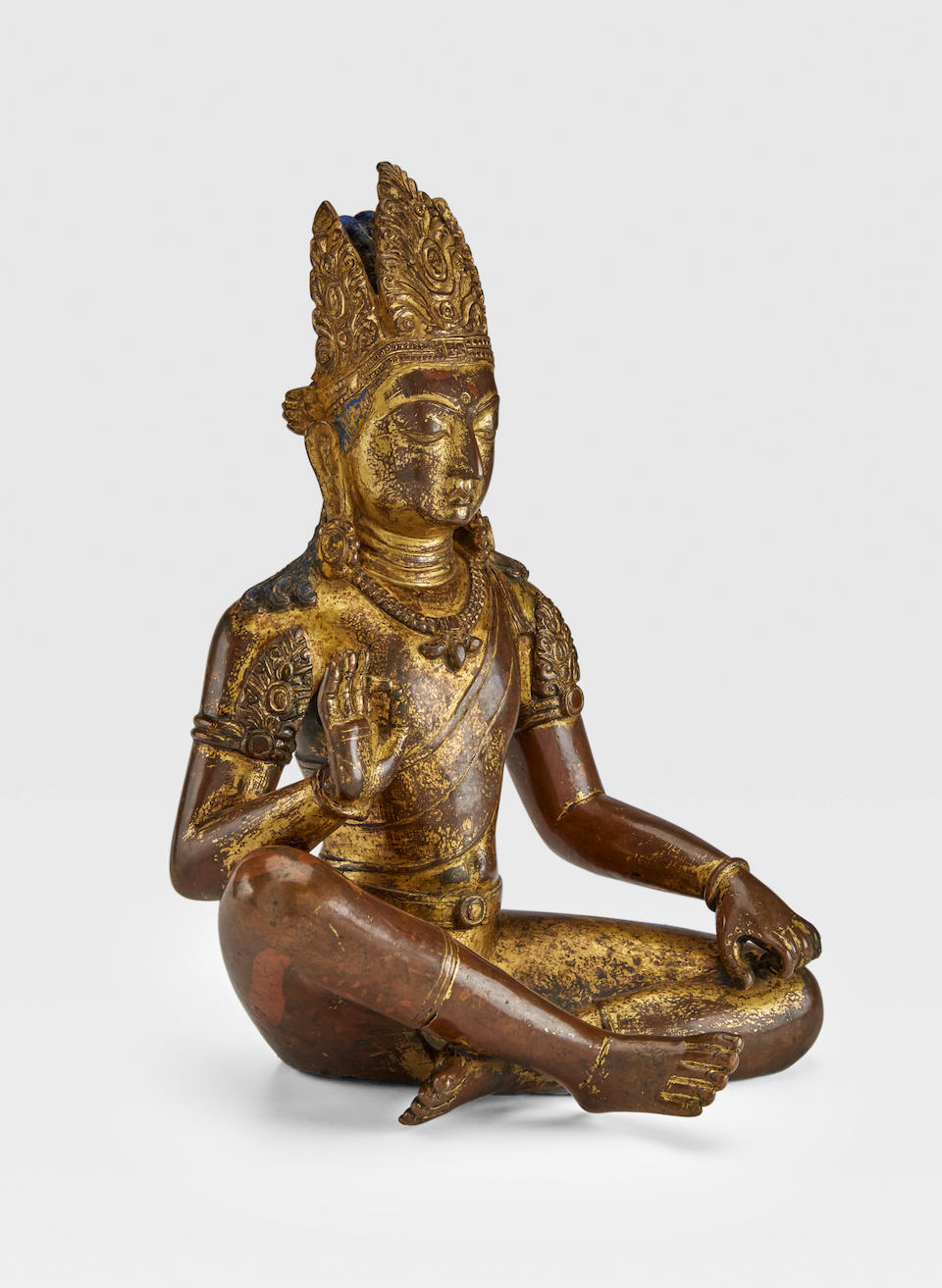 A GILT COPPER ALLOY FIGURE OF MANJUSHRI NEPAL, 9TH/10TH CENTURY