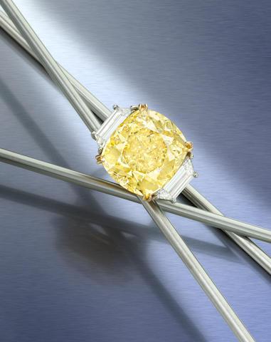 An impressive fancy colored diamond and diamond ring