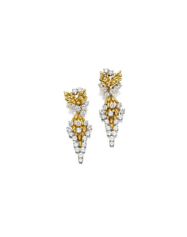 A pair of gold and diamond earclips,
