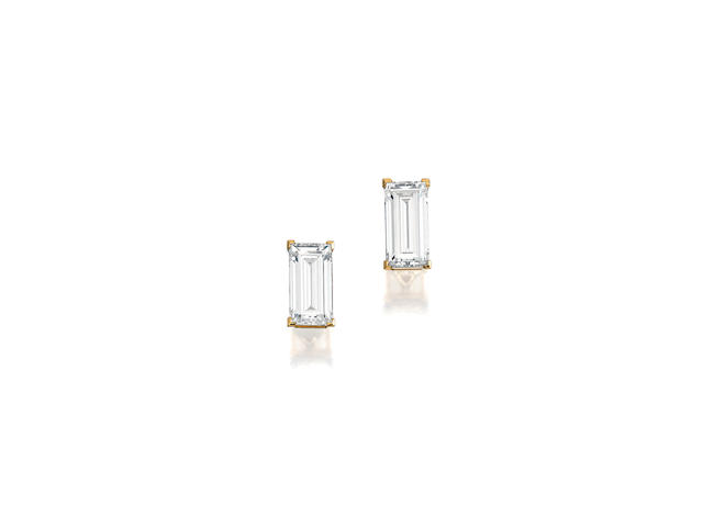 A pair of colored diamond earrings