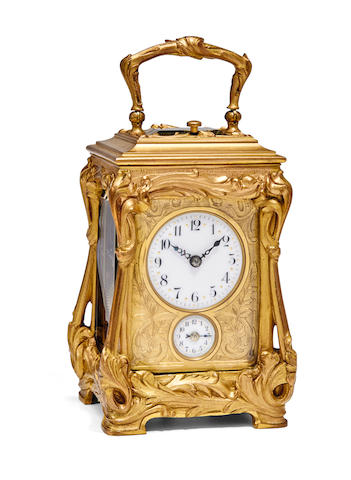 A gilt cast and chased Art Nouveau repeating miniature carriage clock with alarmCirca 1900