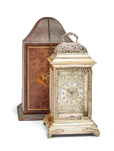 An unusual silver carriage clock in the form of a basket top bracket clock with leather traveling caseCase with London hallmark for 1888