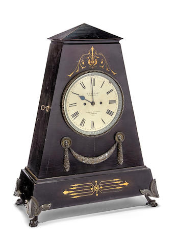 A brass inlaid ebonized and bronze mounted large table clock                             Signed E. Dent & Co., 61 Strand & 34 Royal Exchange, London, No. 1989 Late 19th century