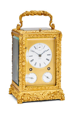 Frederick Courvoisier, La Chaux de Fonds. A fine and rare elaborately cast quarter striking and repeating carriage clock displaying seconds, date and alarmCirca 1830