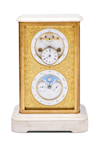 A French Gilt-Bronze and White Marble center seconds Mantle Clock with Brocot Perpetual CalendarCirca 1875