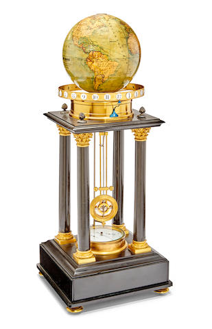 A gilt mounted black marble portico with clockwork globe and year calendarFrench, the globe by Prof. Dr. Otto Delisch, Leipzig Last quarter 19th century