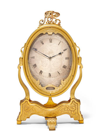 """An engraved gilt cheval glass timepieceSigned, """"Tho's Cole for H & C Tessier 38 South Audley St., Grosvenor Sq., No. 1708"""" Mid 19th century"""