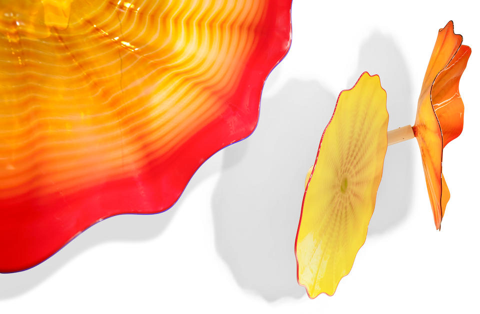 Dale Chihuly (Born 1941) Yellow, Red and Orange Persian Wall Installationcirca 2000blown glass, apparently unsigneddiameters 32 1/2 to 38in  (82.5 to 96.5cm)