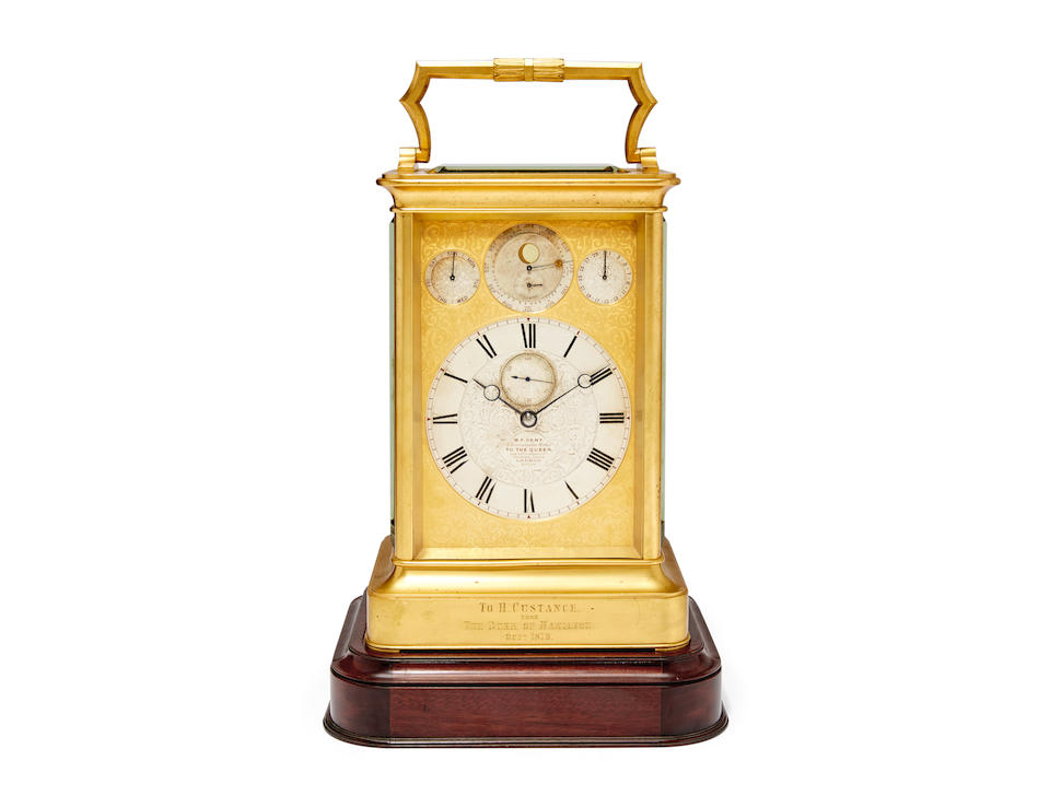 An important gilt giant chronometer escapement quarter chiming carriage clock with perpetual calendar and moon phase, displaying the Equation of Time, on turntable basesigned, M. F. Dent, London, no 24128 Circa 1862