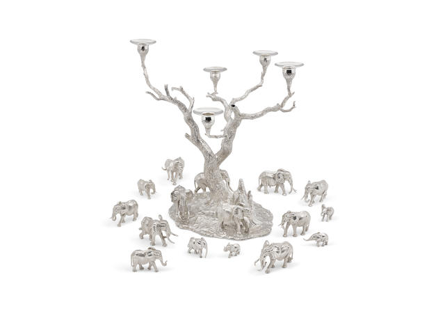 A Patrick Mavros sterling silver Tree of Lights candelabrum and assembled set of Thirteen modeled elephants each piece marked PM and the candelabrum signed 'Patrick Mavros' on base, circa 1998