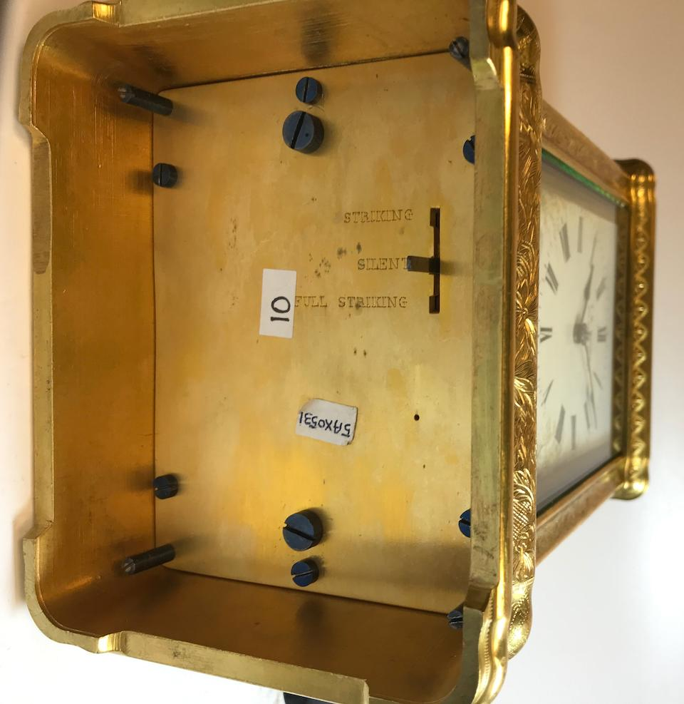 A very fine engraved gilt grande sonnerie striking and quarter repeating porcelain paneled giant carriage clockRetailed by J. W. Benson, London Last quarter 19th century