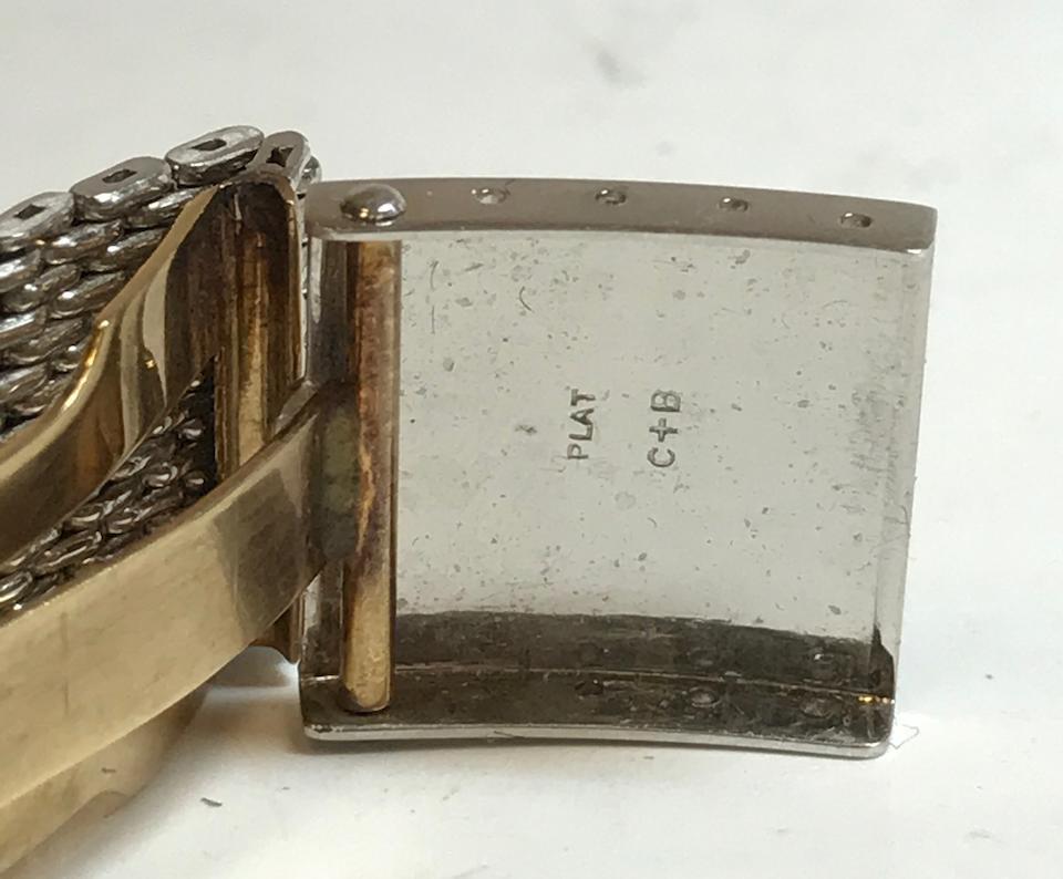 Patek Philippe. A very fine platinum rectangular wristwatch with diamond numerals and a platinum mesh braceletRef: 425, 1948