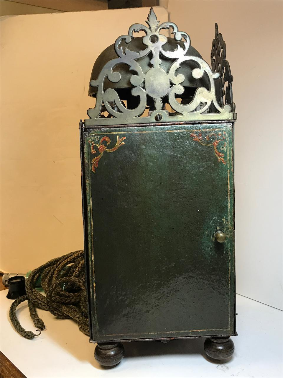 A Dutch painted iron and brass striking chamber clock with alarmLate 17th century