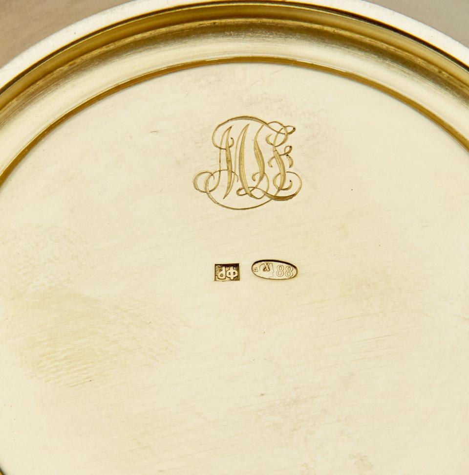Eight GUILLOCHÉ, CHAMPLEVÉ AND PLIQUE-À-JOUR ENAMEL SILVER-GILT DEMITASSE CUPs, SAUCERS AND TEASPOONSFedor Rückert, Moscow, 1908-1917; porcelain inserts: Kornilov Porcelain Factory, early 1900s
