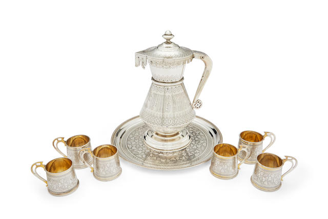 "A parcel-gilt liqueur drinking service in the Russian styleSt. Petersburg and Moscow, 1878, maker's marks: in Latin 'JR' (tray and cups), in Cyrillic 'IS"" (jug)"