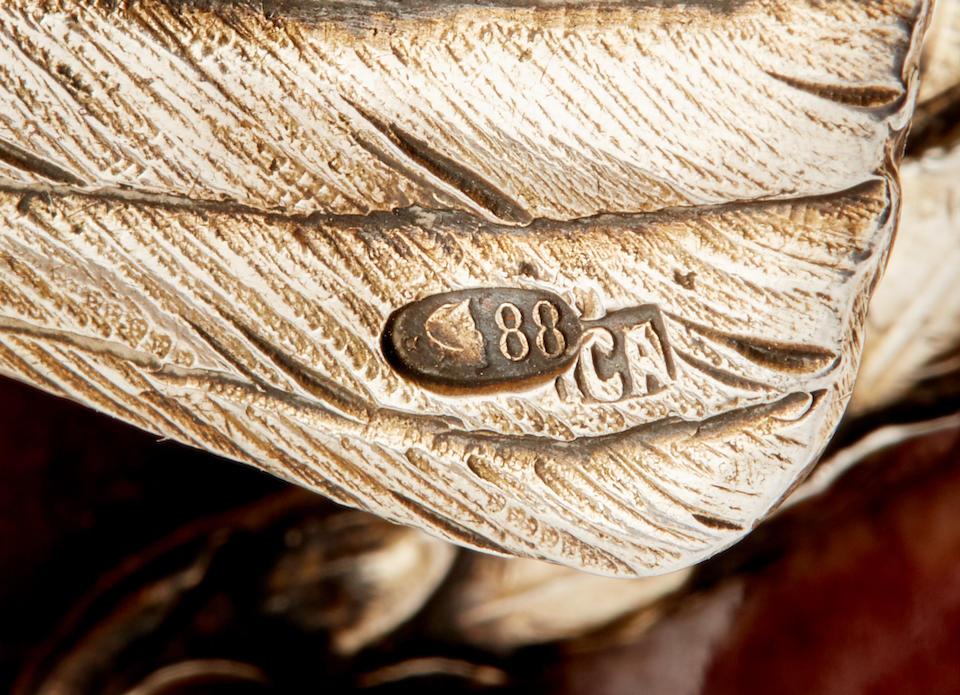 A rare silver-gilt mounted rhodonite mantel clockFabergé, First Silver Artel, former workshop of Julius Rappoport,  St. Petersburg, 1910-1917, scratched inventory number '22107'