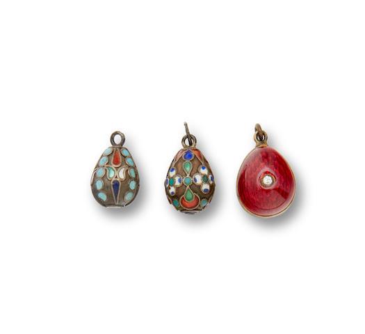 Three silver-gilt and enamel miniature egg pendantsfirst: St. Petersburg, c. 1903, mark of Aleksandr Dal'man; second: unmarked; third: with 84 standard mark