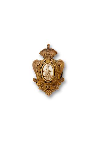 A bronze, gold and enamel badge of the 23rd Nizovsky RegimentK.I. Bok, Petrograd, c. 1918