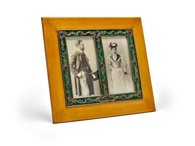 A large jewelled silver-gilt, enamel and wood double-photograph frame Fabergé, workmaster Viktor Aarne, St. Petersburg, 1899-1908