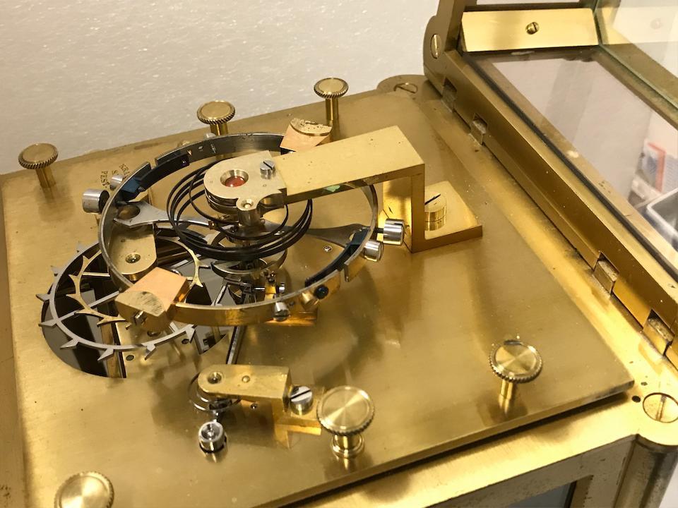 A remarkable glazed gilt brass giant mantel timepiece with visible chronometer escapement made for the 1873 Vienna International ExhibitionSigned Samuel Králik fecit Pestini  Circa 1870