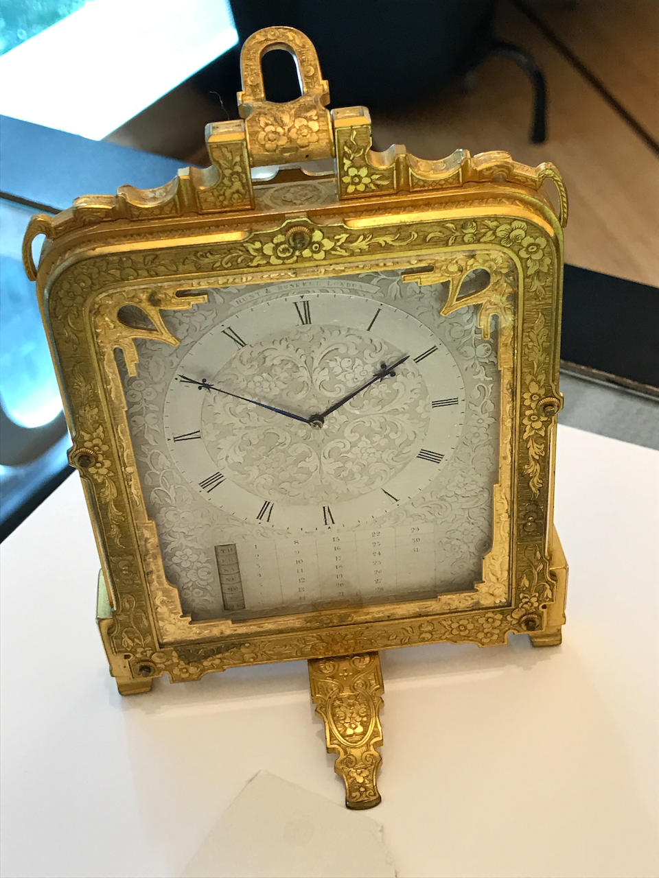 An Engraved gilt brass strut timepiece with calendar in original presentation caseSigned Hunt & Roskell, London Mid 19th century