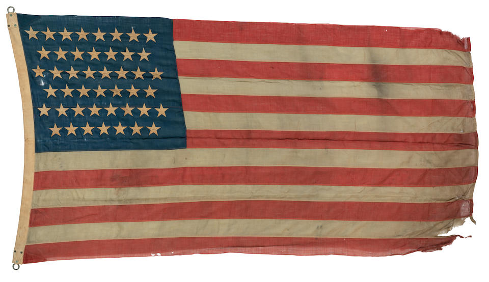 SPANISH-AMERICAN WAR: THE FIRST AMERICAN FLAG TO BE RAISED IN THE PHILIPPINES. [Raised at Camp Dewey, Manilla Bay, Luzon, Philippines: July 1898.]