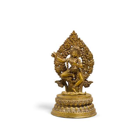 A gilt metal alloy figure of Vajravarahi Nepal, 19th/20th century
