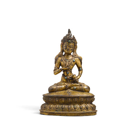 A seated gilt metal alloy figure of Vajrasattva  Tibet, circa 16th century