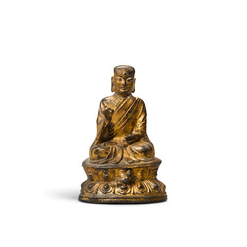 A gilt lacquered bronze seated figure of a luohan 16th/17th century