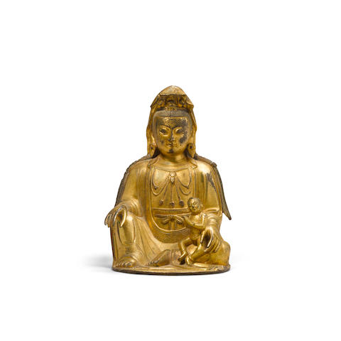 A gilt copper alloy seated figure of the Songzi Guanyin 17th/18th century