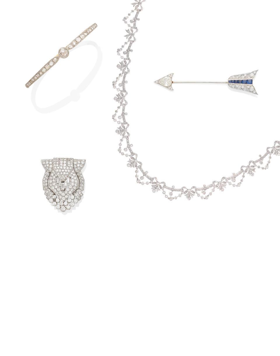A diamond and sapphire arrow jabot pin