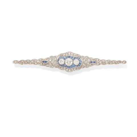 A diamond and sapphire bar brooch,