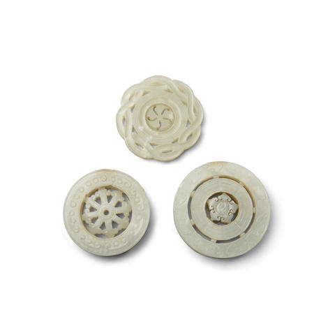 Three jade circular plaques undercut with movable roundels  Late Qing/Republic period