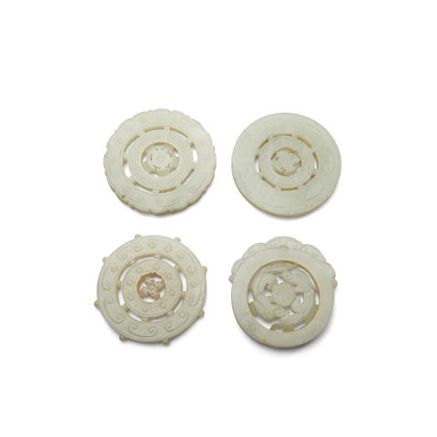 Four circular jade pendants  (4)